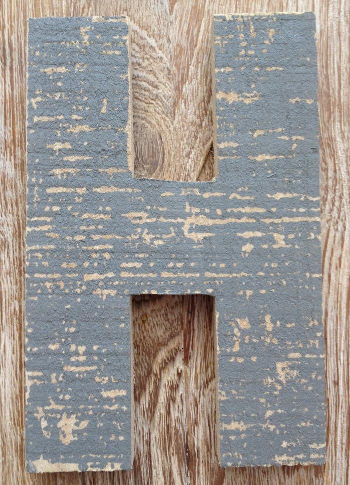 houten letter Xenos